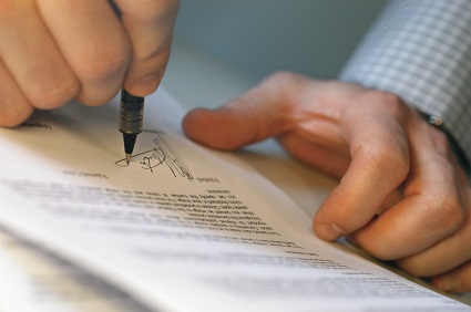 Man's Hands Signing Document